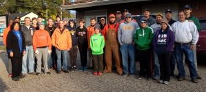 The group from Brother Rice High School gathers in the parking lot before heading out to help Meals on Wheels recipients.